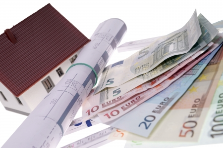 architectural drawing: small house with architectural drawing and euro banknotes