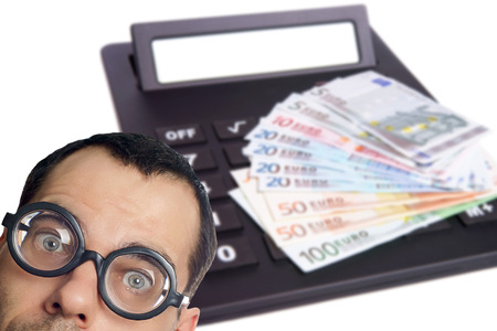 high priced: Man with glasses and calculator with euro banknotes Stock Photo