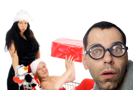 two women in Christmas Shopping and man with glasses photo