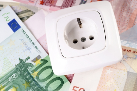 power suppliers: Socket and euro banknotes Stock Photo