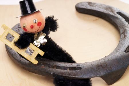 Chimney sweep with horseshoe photo