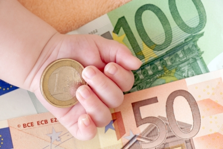 household money: Hand of a baby with euro money Stock Photo
