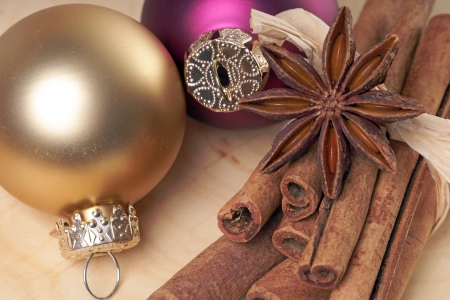 Christmas baubles with cinnamon sticks and star anise photo