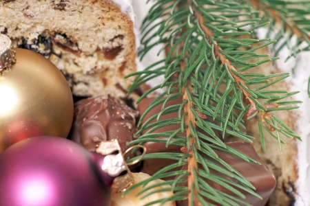 Christmas stollen with fir branch and christmas baubles photo