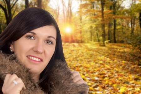 young woman in autumn forest photo