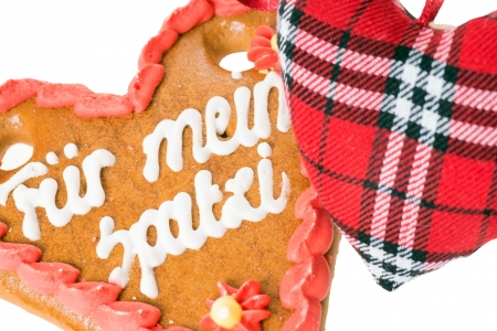 love proof: gingerbread heart with the german words for my Spatzi and small fabric heart Stock Photo