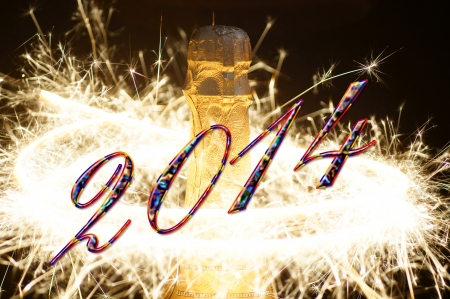 Champagne bottle with fireworks and the year number 2014 Stock Photo - 24486579
