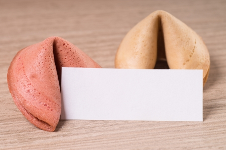 Fortune cookies with empty note over a wooden background photo