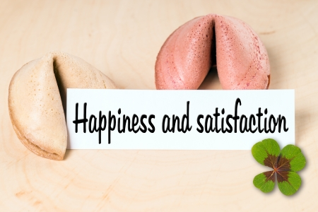 fortune cookies with the  words Happiness and satisfaction photo
