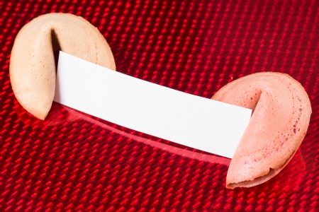 Fortune cookies with blank note over a red background photo