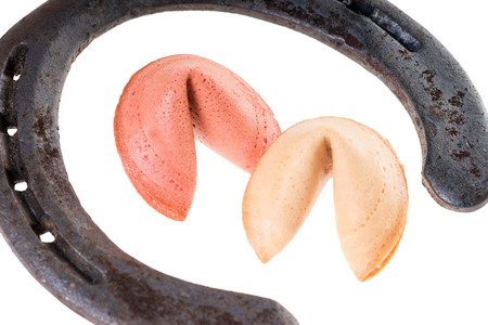 Fortune cookies with horseshoe isolated over a white background photo