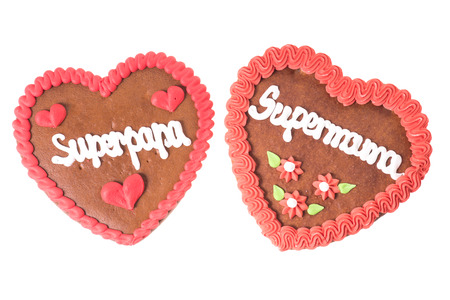super dad: Gingerbread Heart with the german words Super Mom and Super Dad isolated over a white background