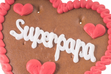 super dad: gingerbread Heart with the german words Super Dad Stock Photo