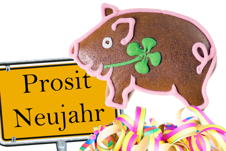 prosit: shield with the german words Prosit Neujahr with a lucky pig and garland