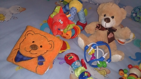 playpen: Teddy bear and toys in a playpen for babies