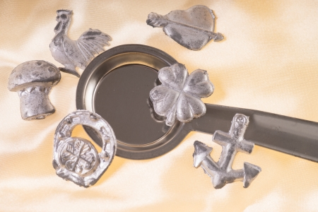 jahreswechsel: Lead pouring set on a gold  Stock Photo