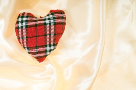 plaid fabric heart on a gold  photo