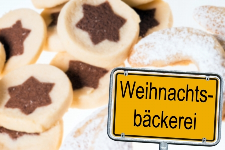 configured: delicious cookies with vanilla crescents and sign with the german words Christmas Bakery Stock Photo