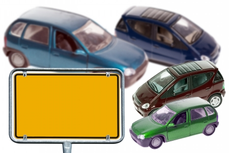 Model Cars and empty sign over a white background photo