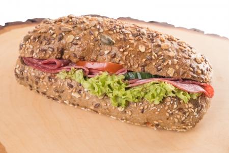 dinnertime: Sandwich on a wooden board Stock Photo