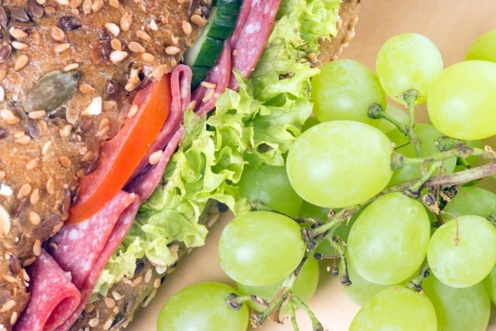 dinnertime: sandwich and grapes