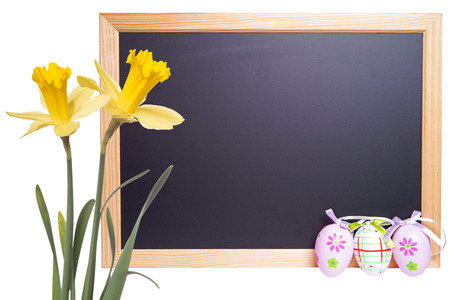 Chalkboard with Easter eggs and daffodils photo