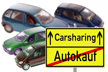 Model cars and Sign with the german words carsharing and car buying photo