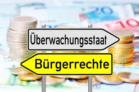 liberties: signpost with the german words surveillance state and civil rights over a background with euro money Stock Photo