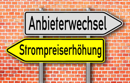 suppliers: Sign with the german words changing suppliers and electricity price increase Stock Photo