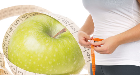 Apple with tape measure and Woman with tape measure photo