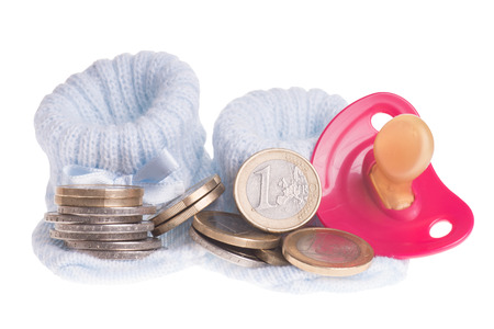 little baby shoes and euro coins with pacifier isolated over a white background photo