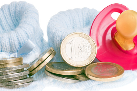 little baby shoes and euro coins and pacifier photo