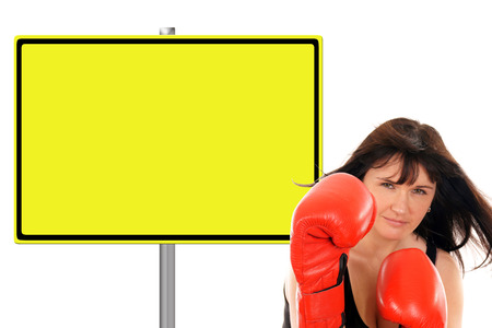 Woman with boxing gloves and advertising sign photo