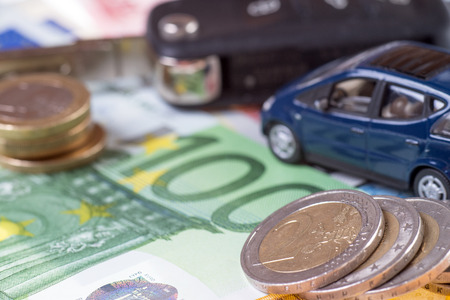 editions: car and euro money with car key