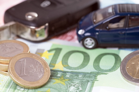 car and euro money with car key photo