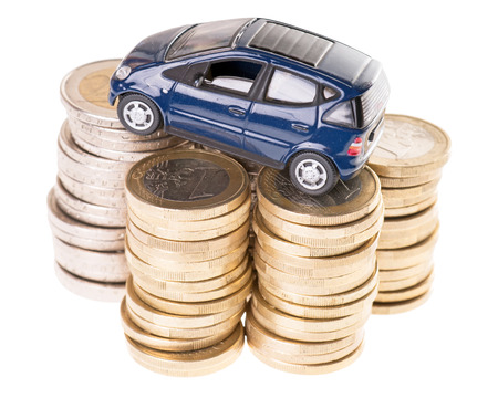Car and Euro coins isolated over a white  photo