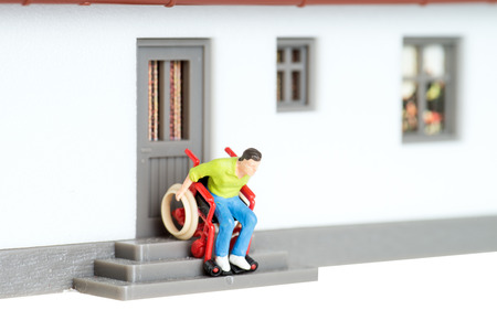 Wheelchair user on an exterior staircase photo