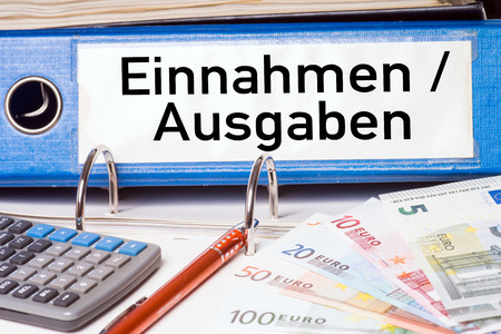 budgetary: File folder with the german words Revenue and expenditure Stock Photo