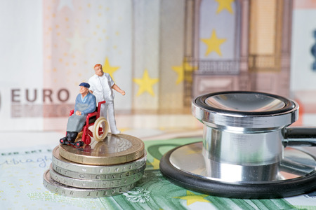 wheelchair user with nursing staff and euro money with stethoscope photo