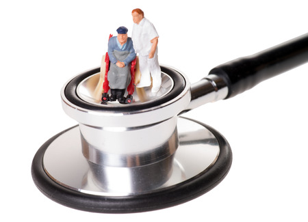 long term care services: wheelchair user with nursing staff stethoscope
