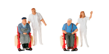 long term care services: wheelchair user with nursing staff over a white background
