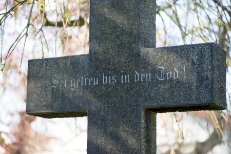 Grave stone with the german words Be thou faithful unto death