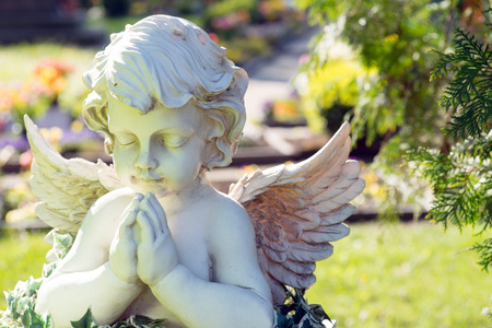 guardian angel: Angel figure in a cemetery