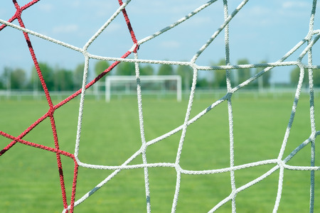 soccer net: Football field with soccer net Stock Photo