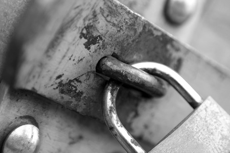 connectedness: old padlock in black and white