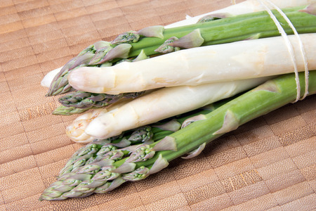 fresh Asparagus over a wooden background photo