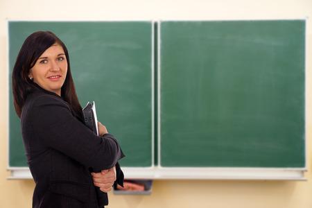 vocational high school: Student in front of an empty school chalkboard