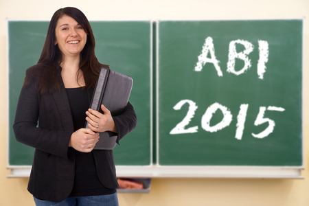 abi: Student in front of a chalkboard and the german word ABI 2015