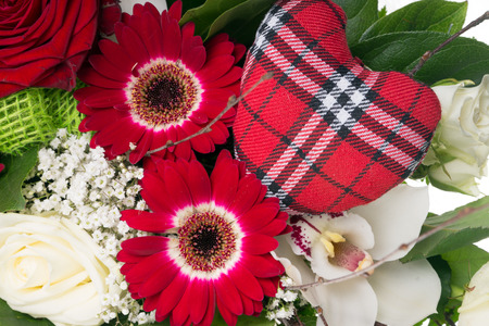 love proof: colorful bouquet of flowers with fabric heart