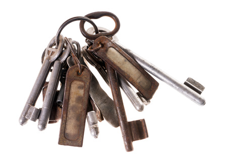 keychains: old rusty key isolated over a white  Stock Photo